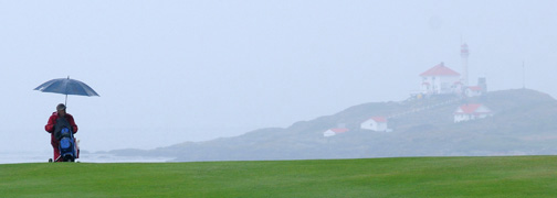 Don Denton photography of a golfer in the rain on Vancouver Island in British Columbia