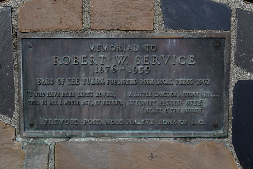 Close up of Robert Service memorial plaque.